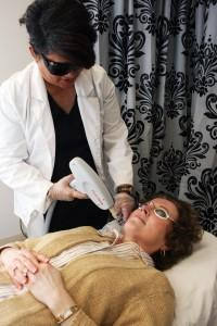 IPL photorejuvenation procedure removing superficial pigments on a patient.