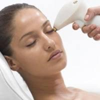 Laser hair reduction treatment in contact with the skin.